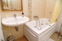 Bathroom with jacuzzi in the apartment of Hotel Panorama in the downtown of Eger